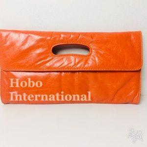 HOBO International Orange Leather Clutch Bag